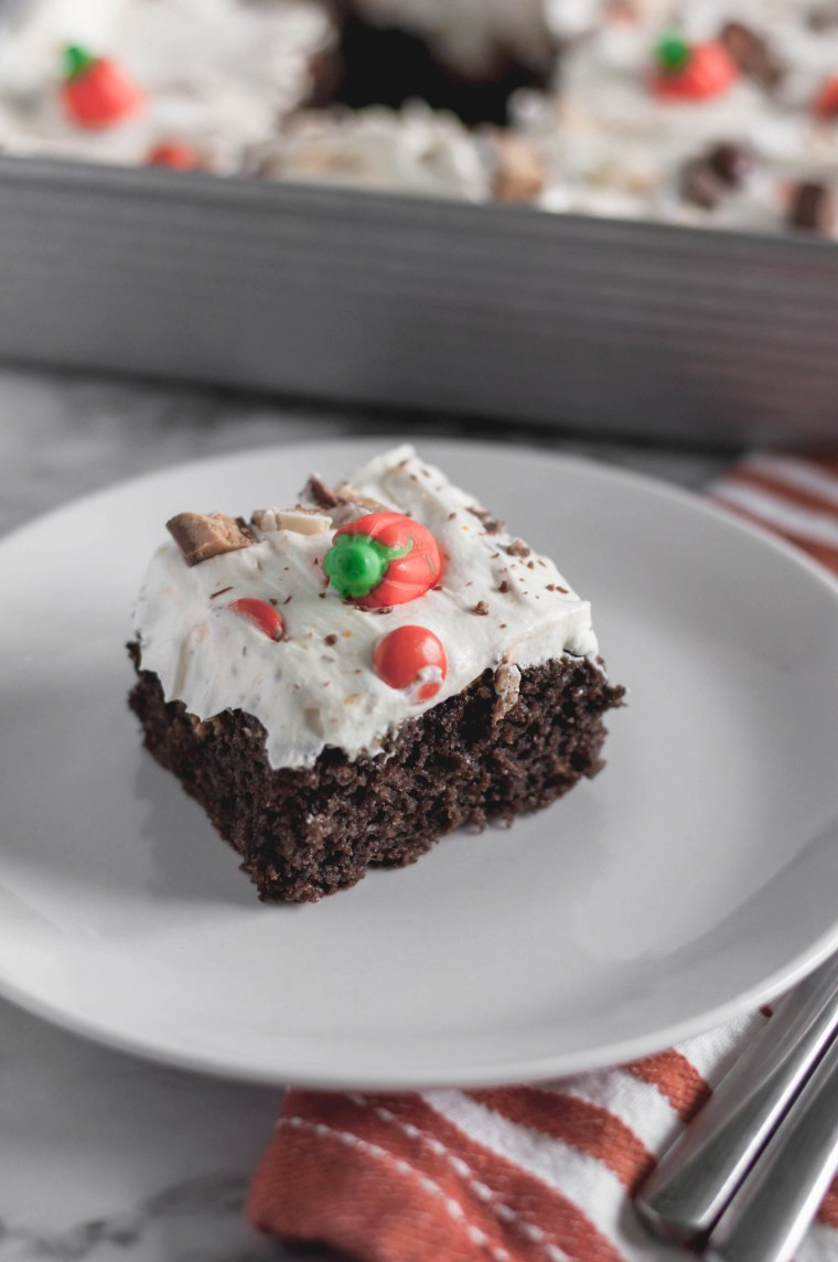 Leftover Halloween Candy Cake is the best way to use up your kids Halloween candy. A doctored up cake mix and 4 ingredient frosting for the win.