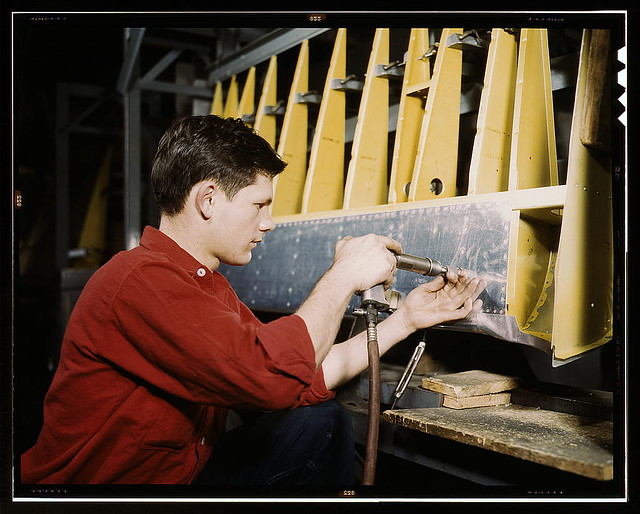 Riveter at work at the Douglas Aircraft Corporation plant in Long Beach, Calif. (LOC)