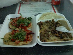 Al Pastor taco and some cheesy beef mix