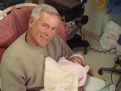 Grampa holds Maddie for the first time