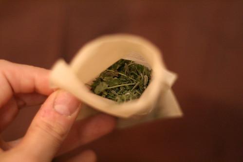 Homemade herbal tea goes into a tea bag