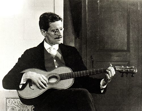 James Joyce in Trieste, 1915. (Photograph by Ottacaro Weiss, a friend who was scandalized by Joyce's guitar playing.)