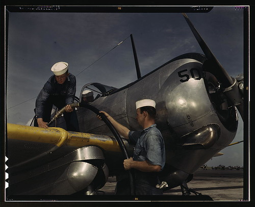 Feeding an SNC advanced training plane its essential supply of gasoline is done by sailor mechanics at the Naval Air Base, Corpus Christi, Texas LOC