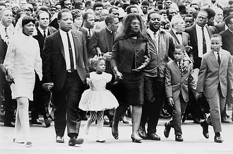 The King children as we knew them on the day of their fathers funeral.  From left to right, Yolanda 12, her uncle Rev. A.D. King, Bernice, 5, who lay on her mothers lap in another iconic photo; their mother Coretta Scott King; Rev. Ralph Abernathy, and sons Dexter, 7, and Martin Luther King III, 10 (Courtesy: Many Blessing to Come)