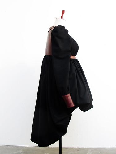 bara baras - coat draped side