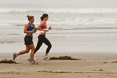 Two female joggers on foggy Morro Strand State...