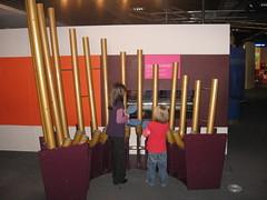 Children playing on an organ-like instrument.