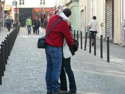 a couple embrace and kiss