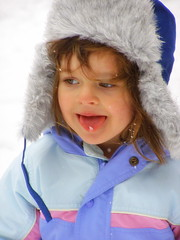 Ruby catching snowflakes on her tongue. (c) Hilltown Families