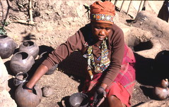 Zulu woman making pot at reconstructed traditi...