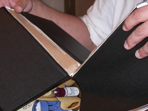 Removing the cover from the spine.