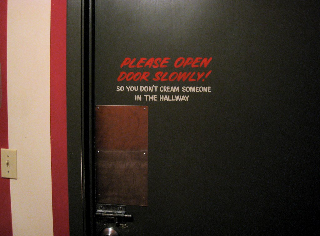 A door with humorous instructions on how to open it
