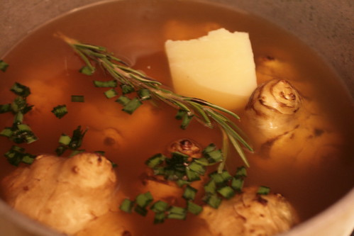Sunchokes stew with rosemary sprig and chives