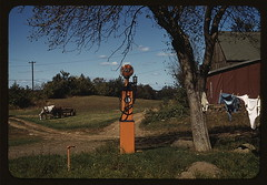 [Gas pump with clothesline, barn and horse-dra...