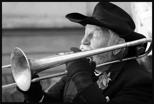 oldman playing the trombone