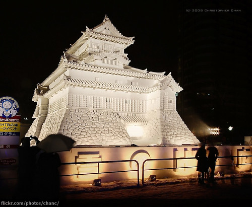 A photo of a huge snow sculpture of a palace.