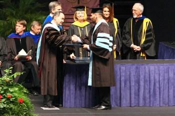 Dr. Higgins receiving his PhD