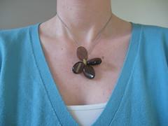 wearing flower necklace
