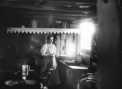 Woman Inside a Settlers Hut