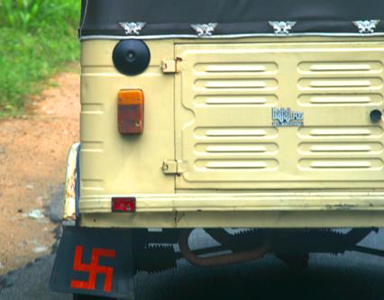 Swathika mud flaps on taxi in rural Sri Lanka