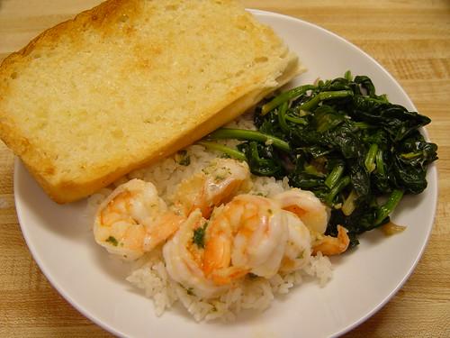 Spinach, garlic bread, and shrimp scampi
