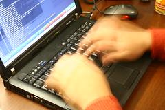 Me typing at my laptop's keyboard