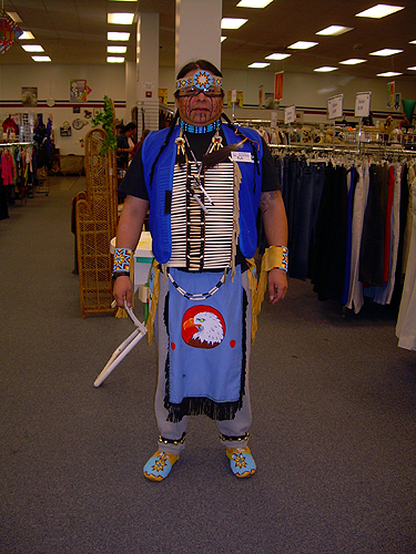 Goodwill worker in pow-wow outfit