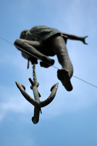 Figure with a hook, in the sky, on the rope by Szagi