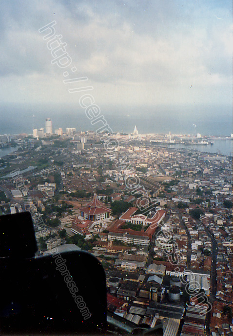 Colombo from a helicopter - Sri Lanka supreme court complex in the foreground. The harbour and downtown area in the back
