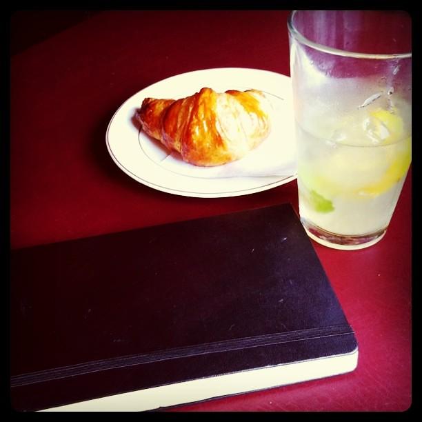 Homemde croissant, mint lemonade, journal