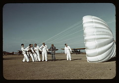 Instructor explaining the operation of a parachute to student pilots, Meacham field, Fort Worth, Tex. (LOC)