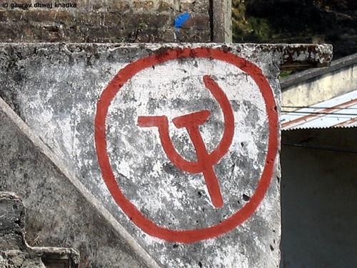 Sickle & Hammer inside a circle by Gaurav Dhwaj Khadka