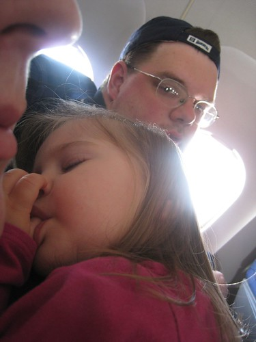 Amelia sleeping on the plane