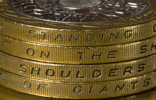 Inscription on the edge of Britain's 2-pound coin; in this photo, four coins are used, to show the entire inscription. Flickriver image