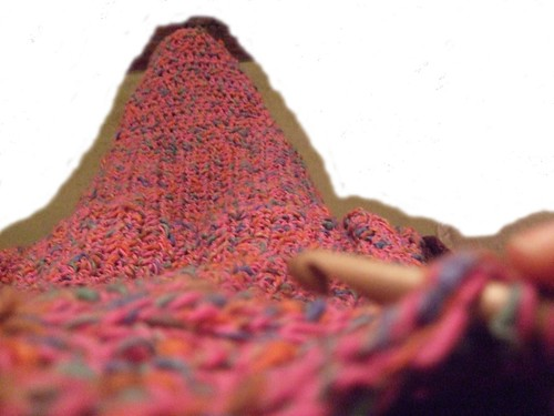 Pink Log Cabin crocheted blanket draped down to feet