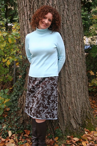 brown boots, new skirt, blue turtleneck, and a tree