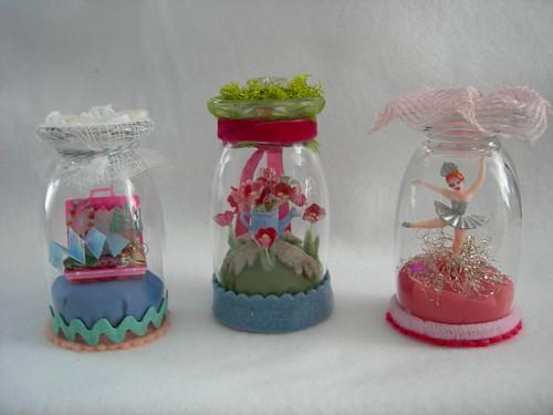 Tiny dioramas under glass