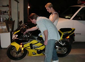 Calvin and Michael drooling over the new motorcycle.  Wow, we still had the Suburban back then.
