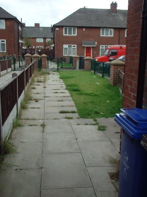 looking from front door out towards front gate - needs some work doing but theres plenty of potential