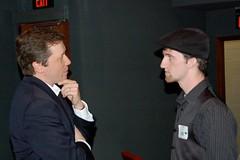 Article image: Chris Jones speaks with Education Commissioner Stephen Bowen.