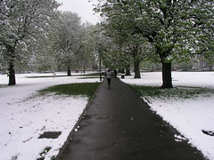 Someone jogging through the snow in London, April 6, 2008