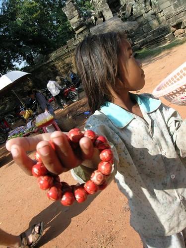 Child selling bracelets