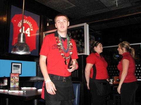 waiter at TGIF wearning Mardi Gras beads 020208