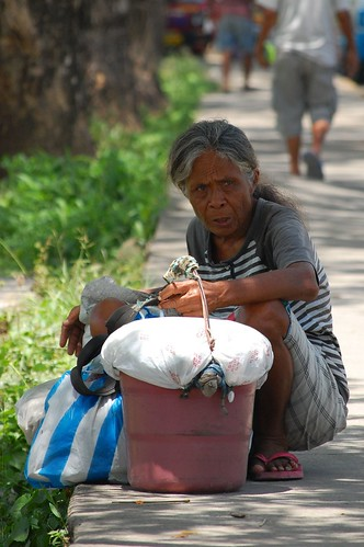 Elderly woman rest beside a footpath Cebu  Consolacion Public Market Pinoy Filipino Pilipino Buhay  people pictures photos life Philippinen  菲律宾  菲律賓  필리핀(공화�) Philippines