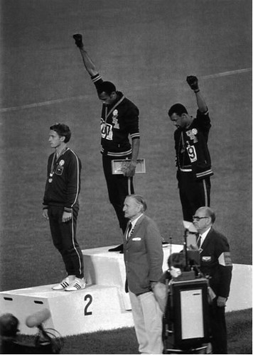 1968 Olympics - Tommie Smith and John Carlos protest by showing black power salutes