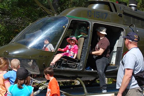 Grace flies a helicopter