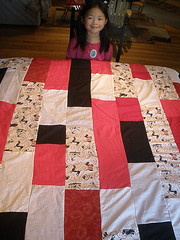Olivia with the Quilt She Made