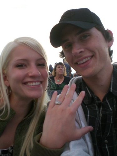 Heres my sweetie and me showing off my new ring.