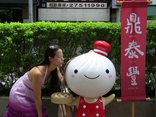 Showing some love to Bao Zai, the Din Tai Fung mascot.  Hes a giant dumpling serving dumplings