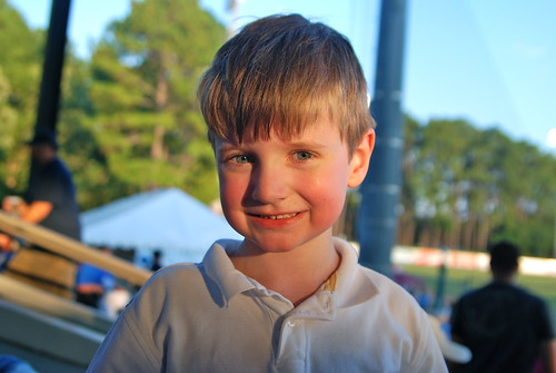 Brian smiling at the baseball game